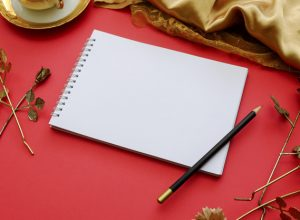 blank-note-book-on-royal-elegant-red-background_1644-68